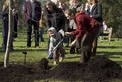 Sarah Hutchinson (WWF) helping her son Eduardo (3) shovel it in